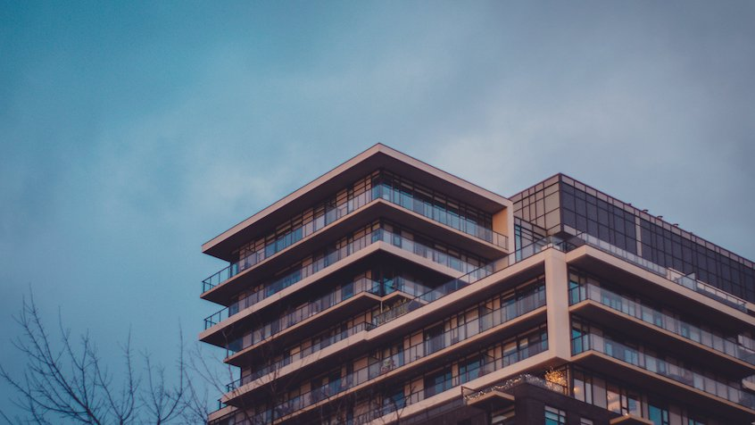 modern-housing-with-blue-sky-real-estate-lending-intro