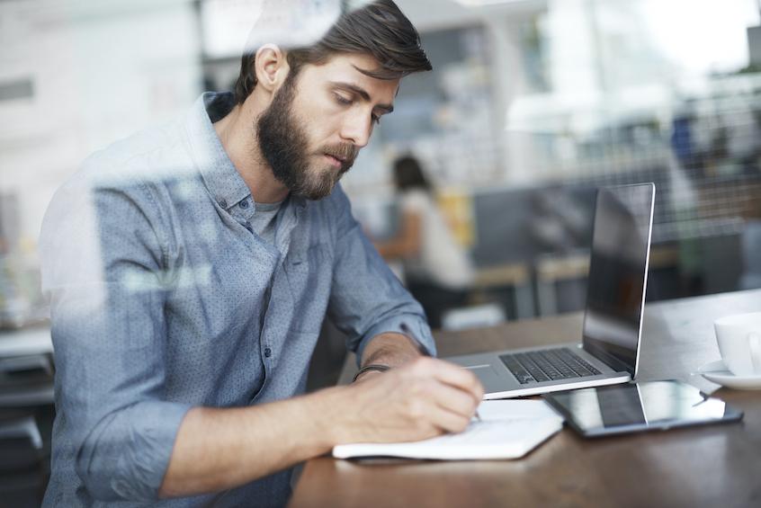 man-taking-notes-evaluating-asset-based-lending-opportunities