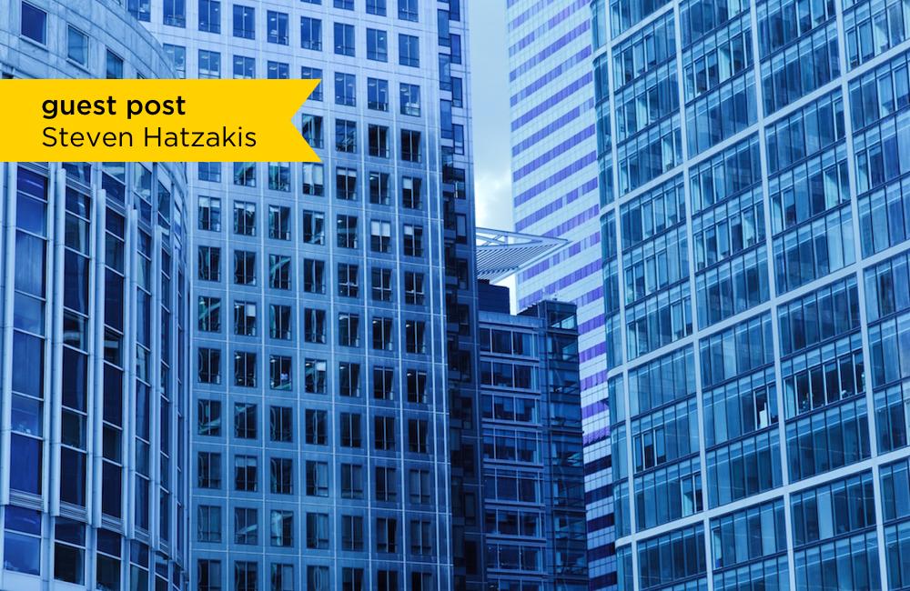 Banner over glass skyscrapers in dense urban area
