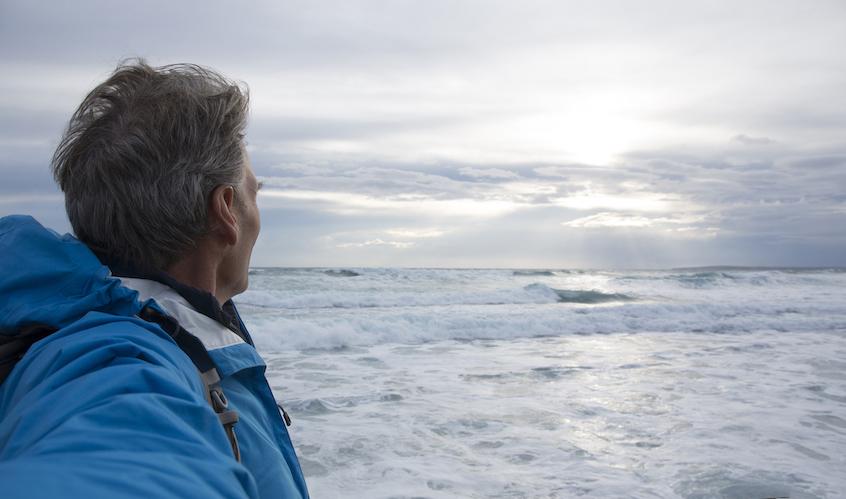 man-looking-at-sea-passive-income