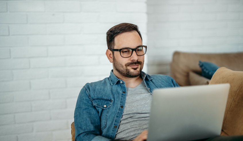 guy-wearing-glasses-working-on-laptop