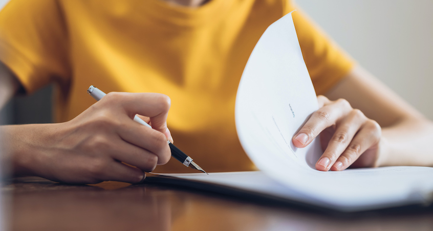 woman-signing-papers-borrower-payment-dependent-notes