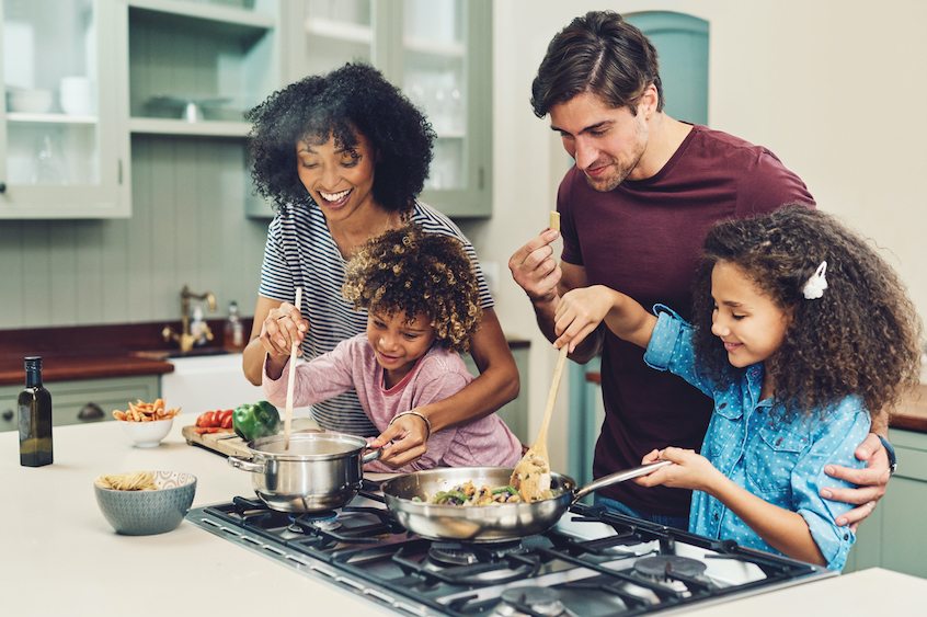 family-cooking-together-passive-income-yieldstreet-perspective