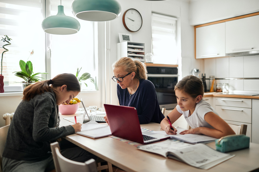 family-mom-and-daughters-doing-home-work-creating-passive-income