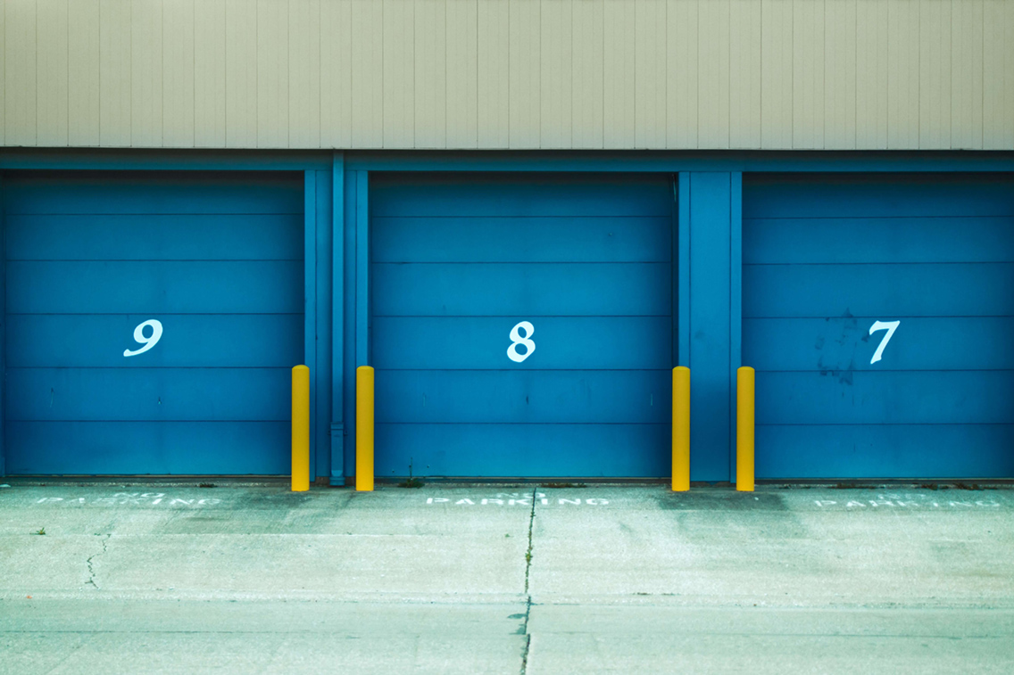Photo of closed storage units also intended to highlight alternative investment opportunities in the real estate space