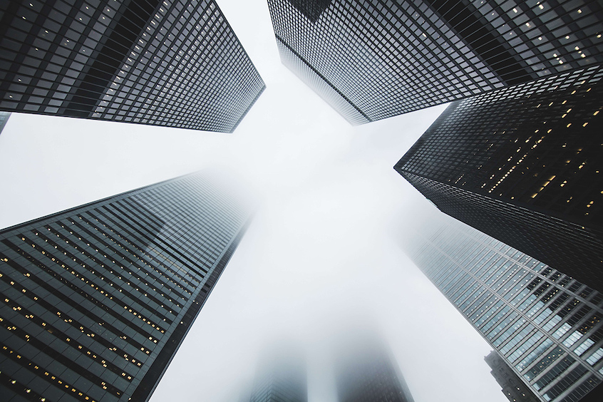Modern office buildings meant to highlight commercial real estate investment opportunities in alternatives