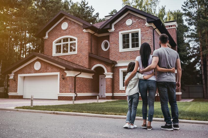 family-outside-single-family-rental-home