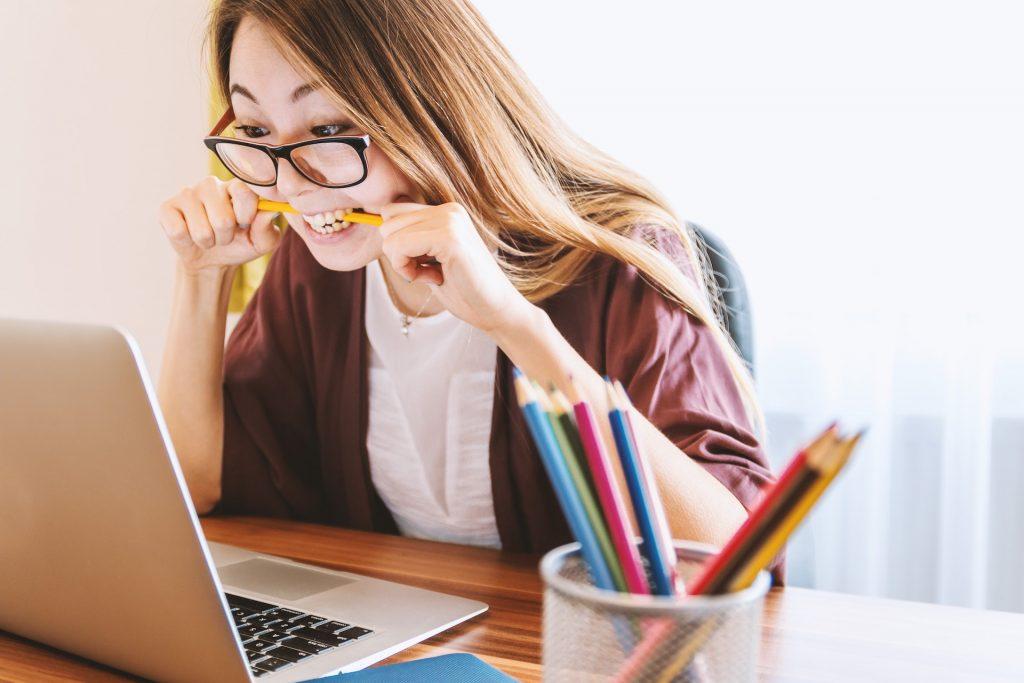 girl-reading-carefully-understanding-yieldstreet-asset-classes