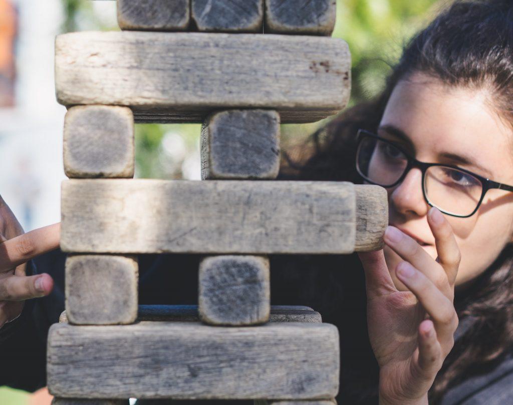 girl-playing-jenga-understanding-your-risk-tolerance