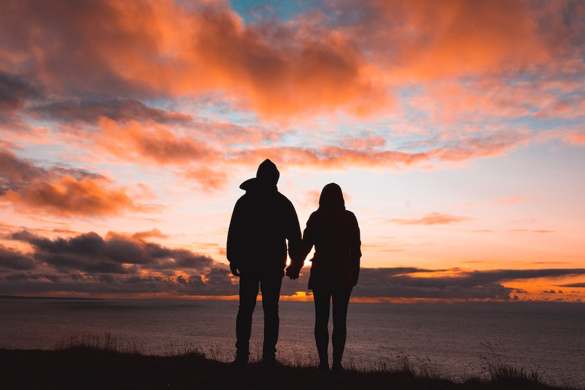 couple-looking-at-sunset-retirement-services-coronavirus-impact