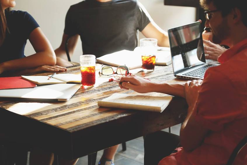 people-sitting-at-table-how-to-become-an-accredited-investor