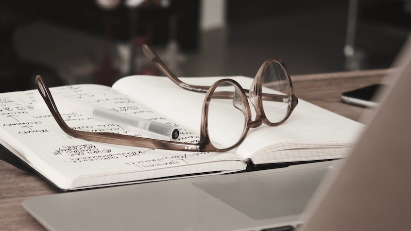 glasses-and-notebook-why-is-it-called-a-self-directed-IRA