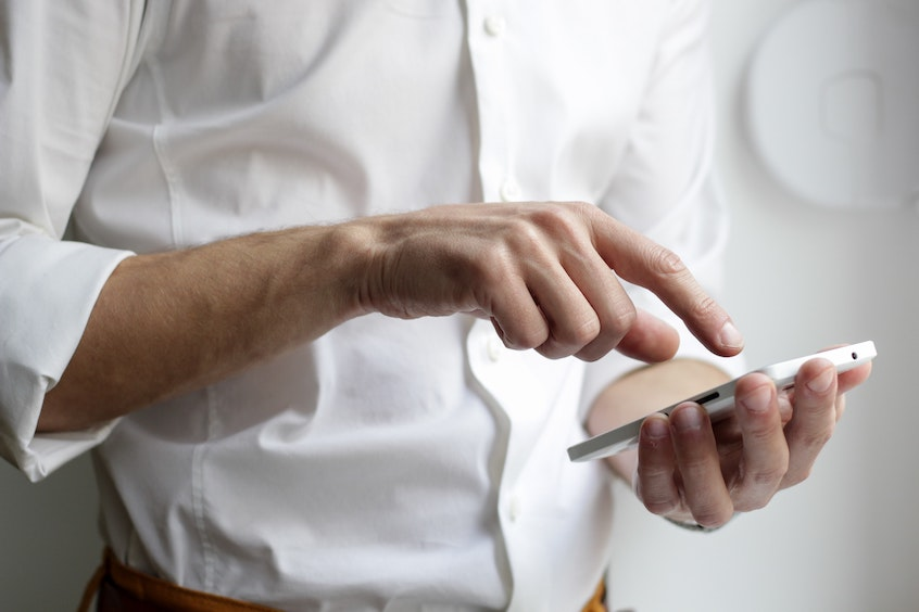 man-on-phone-invest-in-alternative-assets