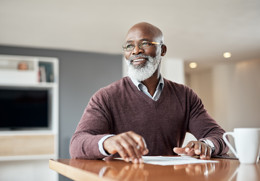handsome-older-gentleman-making-notes-at-table-why-some-iras-file-taxes