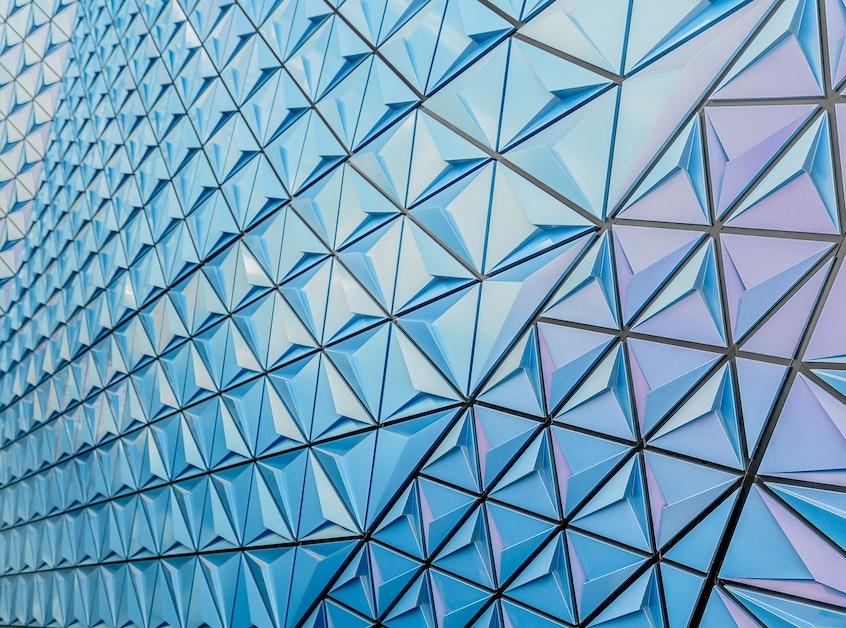 triangular-glass-windows-yieldstreet-prism-fund-investment-strategy