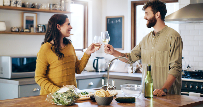 couple-celebrating-making-food-IRA-rollover