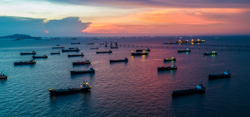 Tankers at sunset meant to showcase an update on Yieldstreet marine portfolio