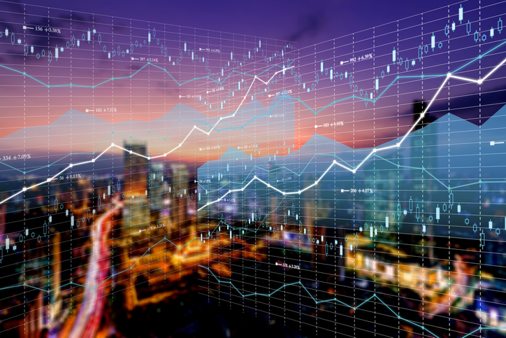Double exposure business technology and abstract financial charts in sky on city background. Business information concept
