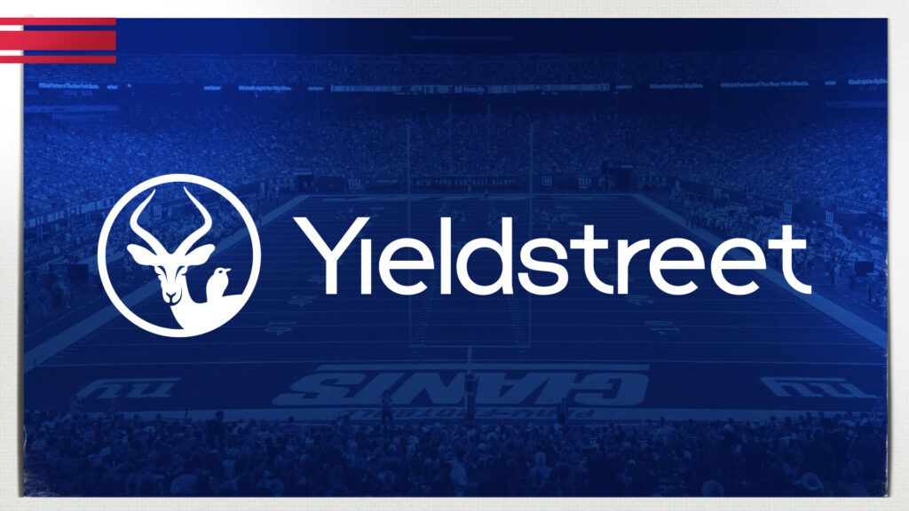Yieldstreet logo over blue background to announce Yieldstreet partnership with the New York giants